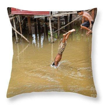 2 Cambodian Boys Dive Color Throw Pillow