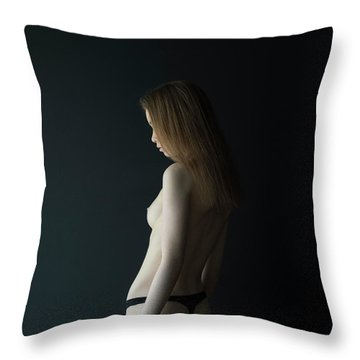 Girl In Front Of Black Wall Throw Pillow