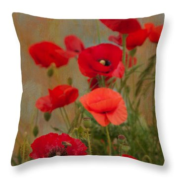Poppies Throw Pillow by Carolyn Dalessandro