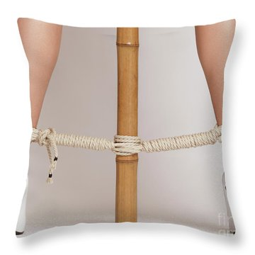 Woman Legs Tied With Ropes To Bamboo Throw Pillow by Oleksiy Maksymenko