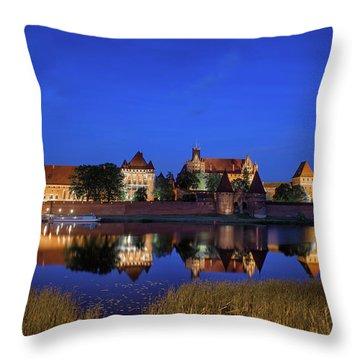 Malbork Castle At Night In Poland Throw Pillow