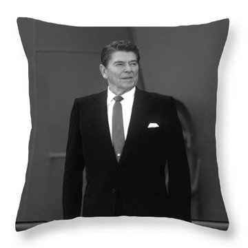 Throw Pillow featuring the photograph President Ronald Reagan by War Is Hell Store