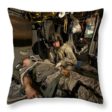 U.s. Army Specialist Practices Giving Throw Pillow by Terry Moore