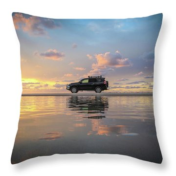 4wd Vehicle And Stunning Sunset Reflections On Beach Throw Pillow