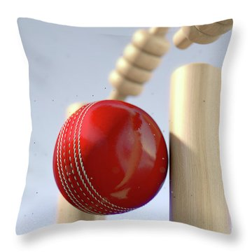Cricket Ball Hitting Wickets Throw Pillow by Allan Swart