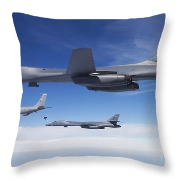 A B-1b Lancer Stands By As Another Throw Pillow by Stocktrek Images