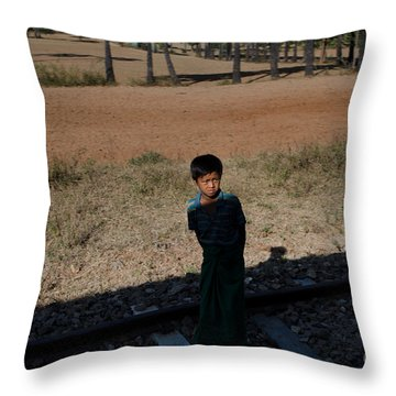 Throw Pillow featuring the photograph A Boy In Burma Looks Towards A Train From The Shadows by Jason Rosette