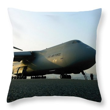 A C-5 Galaxy Sits On The Flightline Throw Pillow by Stocktrek Images
