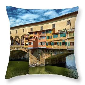 Ponte Vecchio On The Arno River Under A Blue Sky In Florence, Italy Throw Pillow