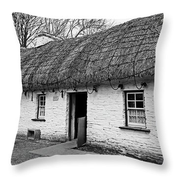 A Country Cottage Throw Pillow by Martina Fagan