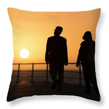A Couple In Silhouette Walking Into The Sunset Throw Pillow