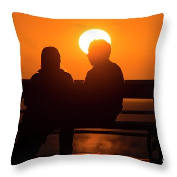 A Couple Sitting At Sunset Throw Pillow