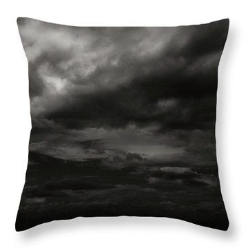Throw Pillow featuring the photograph A Dark Moody Storm by John Norman Stewart