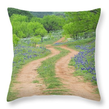 A Dirt Road Lined By Blue Bonnets Of Texas Throw Pillow