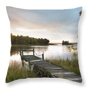 A Dock On A Lake At Sunrise Near Wawa Throw Pillow by Susan Dykstra