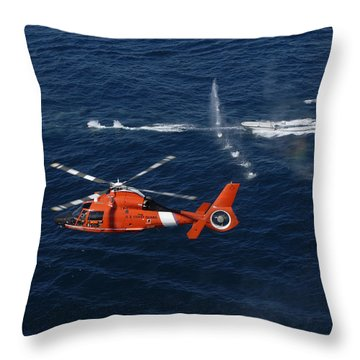 A Helicopter Crew Trains Off The Coast Throw Pillow by Stocktrek Images