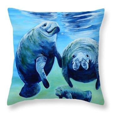 A Manatee Family Throw Pillow