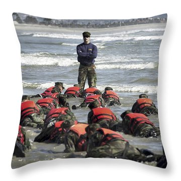 A Navy Seal Instructor Assists Students Throw Pillow by Stocktrek Images