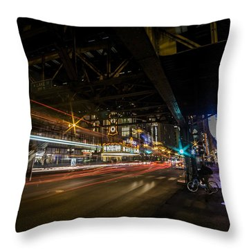 a nighttime look at Chicago's busy State and Lake Intersection Throw Pillow