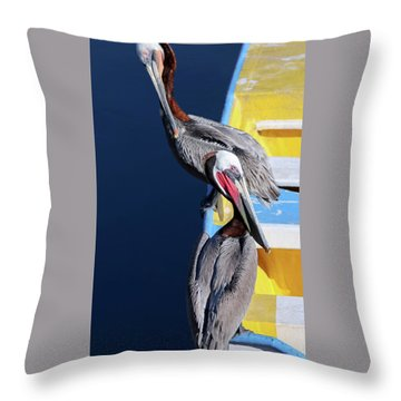 A Pair Of Brown Pelicans On A Blue And Yellow Rowboat Throw Pillow