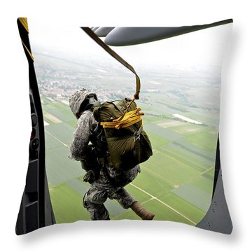Throw Pillow featuring the photograph A Paratrooper Executes An Airborne Jump by Stocktrek Images
