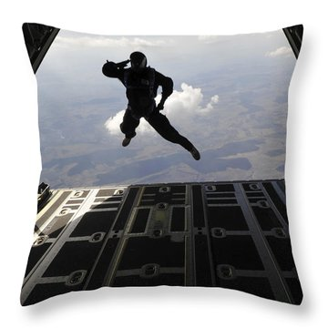 A Paratrooper Salutes As He Jumps Throw Pillow by Stocktrek Images