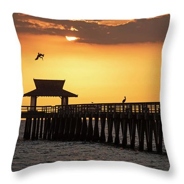 A Pelican Dive-bomb At The Naples Pier Naples Fl Throw Pillow
