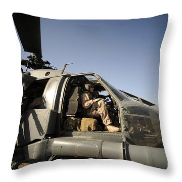 A Pilot Sits In The Cockpit Of A Hh-60g Throw Pillow by Stocktrek Images