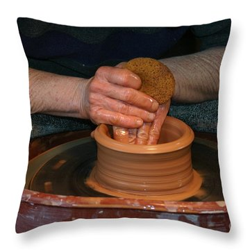 A Potter's Hands Throw Pillow