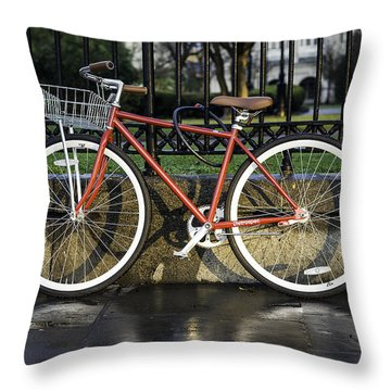 A Red Bicycle Near Jackson Square, New Orleans, Louisian Throw Pillow