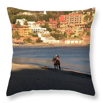 Throw Pillow featuring the photograph A Ride On The Beach by Jim Walls PhotoArtist
