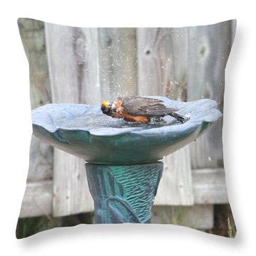 A Robin Enjoying A Bath Throw Pillow