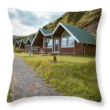 Throw Pillow featuring the photograph A Row Of Cabins In Iceland by Edward Fielding