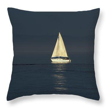 A Sailboat Capturing Light Throw Pillow