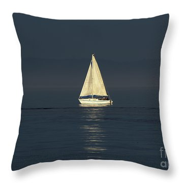 A Sailboat Capturing Light Throw Pillow