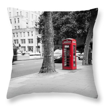 A Single Red Telephone Box On The Street Bw Throw Pillow
