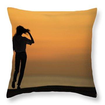 A Slim Woman Walking At Sunset Throw Pillow