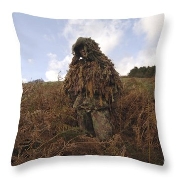 A Sniper Dressed In A Ghillie Suit Throw Pillow by Andrew Chittock