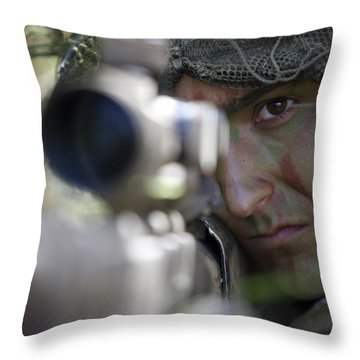 A Sniper Sights In On A Target Throw Pillow by Stocktrek Images