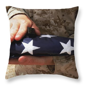 A Soldier Holds The United States Flag Throw Pillow by Stocktrek Images