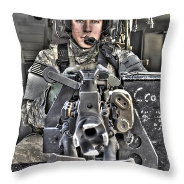 A Uh-60 Black Hawk Door Gunner Manning Throw Pillow by Terry Moore
