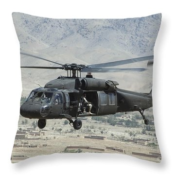 Throw Pillow featuring the photograph A Uh-60 Blackhawk Helicopter by Stocktrek Images