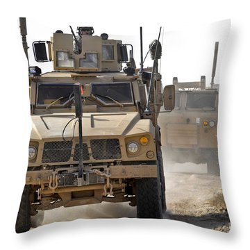 A U.s. Army M-atv Leads A Convoy Throw Pillow by Stocktrek Images