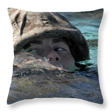 A U.s. Marine Swims Across A Training Throw Pillow by Stocktrek Images
