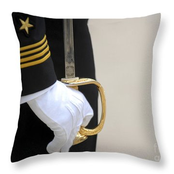 Throw Pillow featuring the photograph A U.s. Naval Academy Midshipman Stands by Stocktrek Images