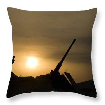 A Us Soldier Mans His .50 Caliber While Throw Pillow by Terry Moore