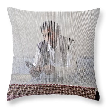 A Weaver Weaves A Carpet. Throw Pillow
