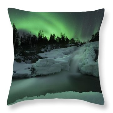 A Wintery Waterfall And Aurora Borealis Throw Pillow by Arild Heitmann
