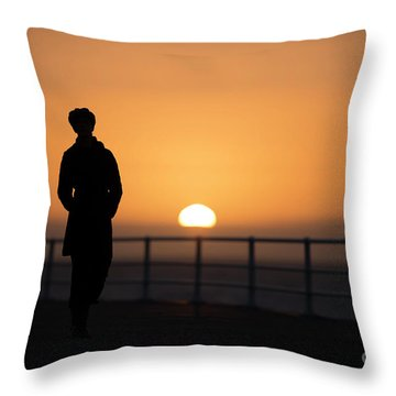 A Woman Silhouetted At Sunset Throw Pillow