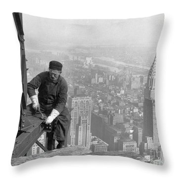 Throw Pillow featuring the painting A Worker Bolts Beams During Construction by Lewis Wickes Hine